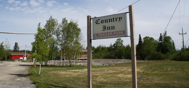 Country Inn & Trailer Park company sign
